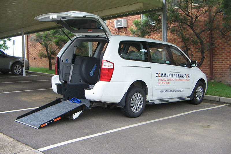 Community transport vehicle with ramp